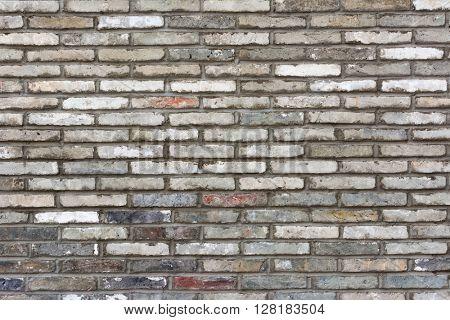 Old grey brick wall background
