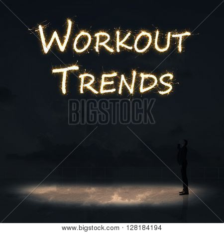Concept of workout trends with a person stand in the outdoor and looking up the text over the sky in the night.