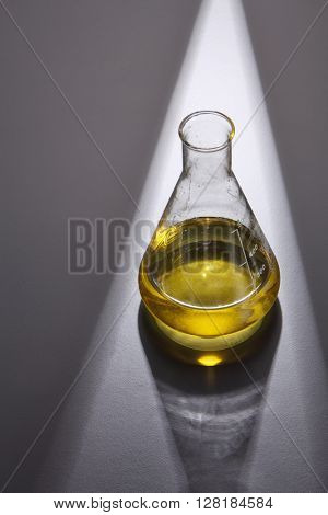 bio diesel in erlenmeyer flask on gray background