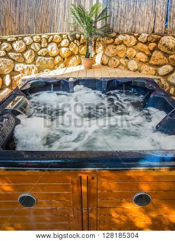 Bath - Jacuzzi in the garden. Water bath boiling