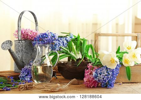 Hyacinth and watering-pot on table indoors