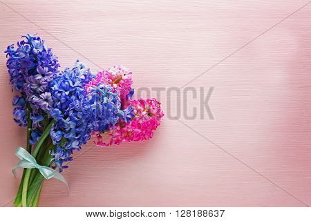Bouquet of hyacinth on pink background
