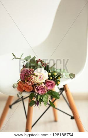 Bouquet of roses on a white chair, closeup