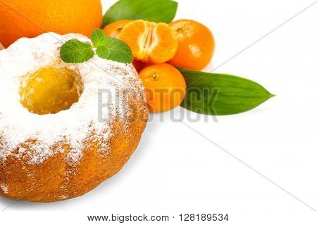 Delicious citrus cake with tangerines and oranges on white background
