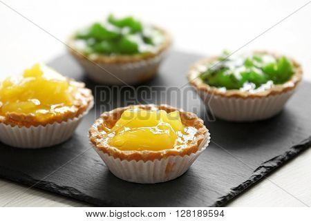 Fresh homemade fruit tarts with citruses and kiwi