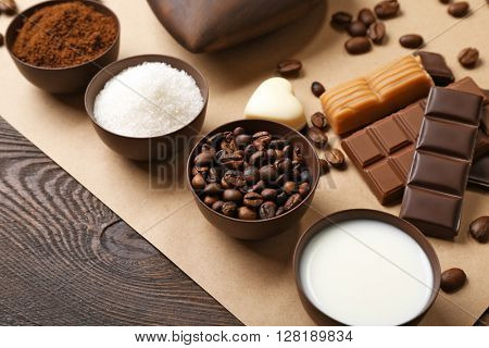 Coffee, sugar and milk on parchment, closeup
