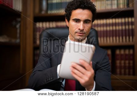 Senior business man using a tablet