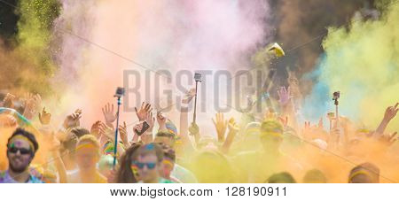 Close-up of marathon, people covered with colored powder. Close-up.