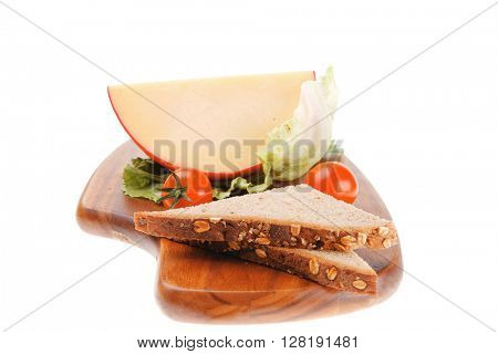 cheese served on wood with bread and salad
