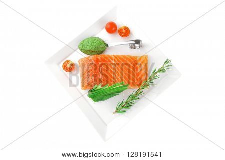 fresh smoked salmon fillet with vegetables and sauce