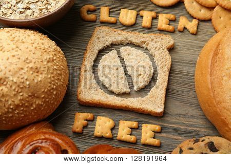 Bread slice with Gluten Free text on wooden table