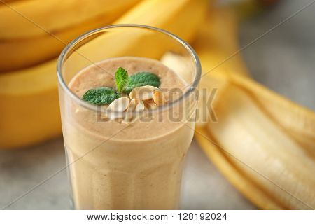 Glass of fresh banana cocktail with peanuts, closeup