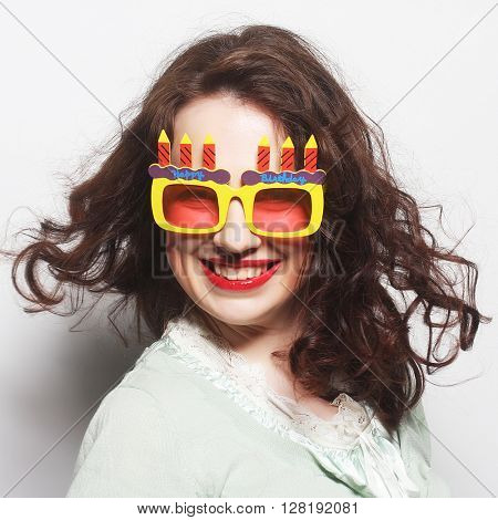 young happy woman with big orange sunglasses