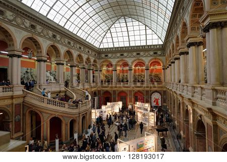 ST. PETERSBURG, RUSSIA - FEBRUARY 25, 2016: People in the big exhibition hall during the celebration of 140th anniversary of Art and Industry Academy named after Alexander von Stieglitz