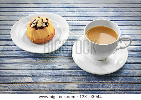 Milk tea with a dessert on wooden background.