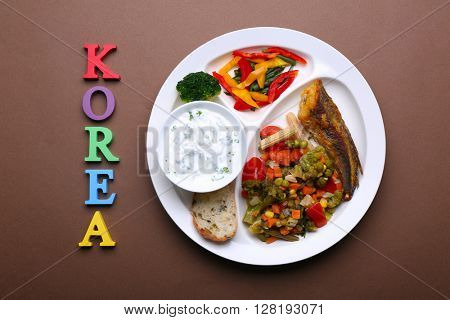 Traditional Korean lunch on brown background