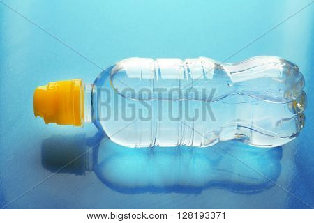 Bottled water on the blue background, close up