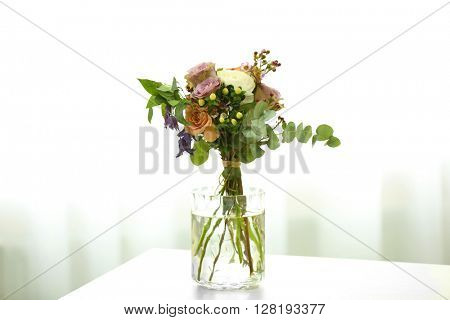 Bouquet of roses in jar on the table
