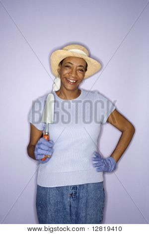 African American mature adult female with hand shovel.