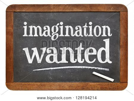 imagination wanted  - white chalk text on a vintage slate blackboard