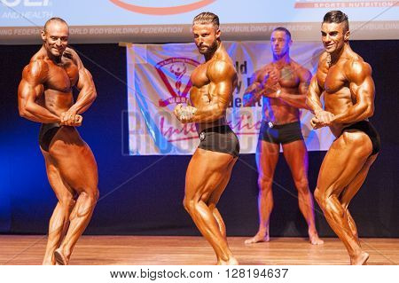 MAASTRICHT THE NETHERLANDS - OCTOBER 25 2015: Male bodybuilders flex their muscles and show their best chest pose at the World Grandprix Bodybuilding and Fitness of the WBBF-WFF on October 25 2015 at the MECC Theatre in Maastricht the Netherlands
