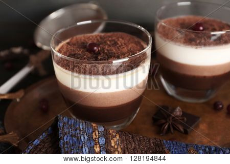 Delicious dessert with chocolate powder and rowan in glass