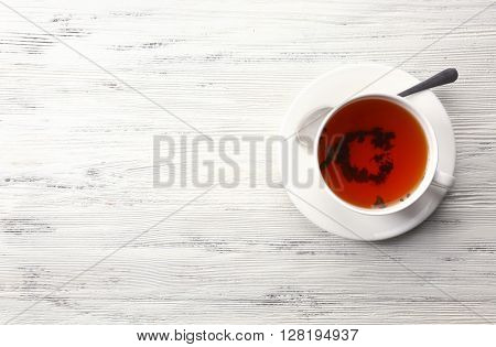 Cup of tea on white table, top view
