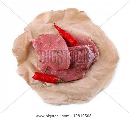 Row beef steak with red chili, isolated on white