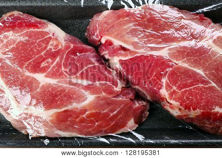 Packed pieces of pork meat, close up
