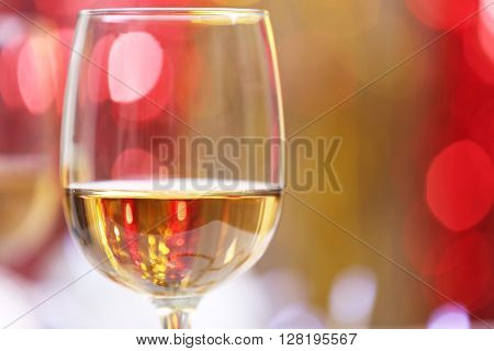 Wineglass on blurred lights background