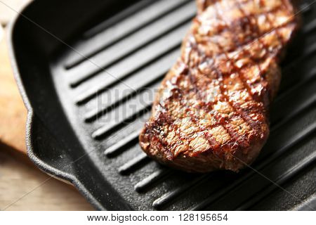 Grilled steak on grill pan, closeup