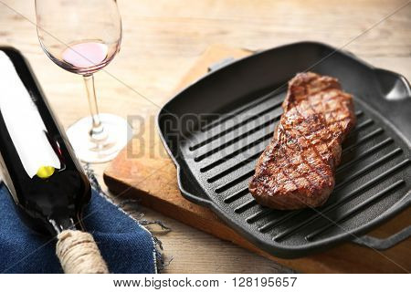 Grilled steak on grill pan with wine