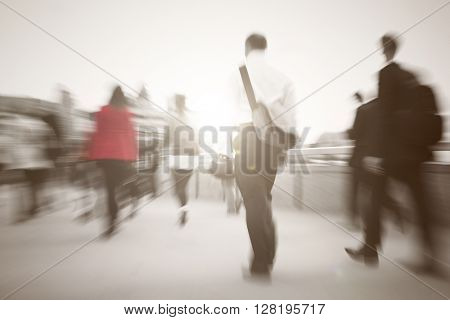 Business people walking to their workplace.