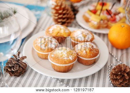 Tasty muffins in a Christmas dinner table