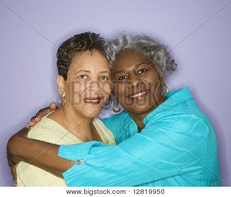 Mature adult African American female looking at viewer smiling.