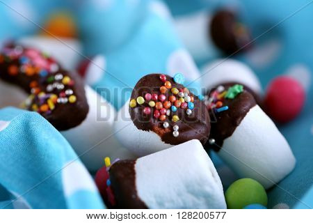 Tasty marshmallows with chocolate, close up
