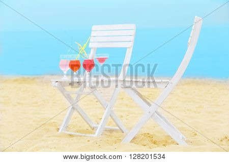 Refreshing cocktail on chair outdoors
