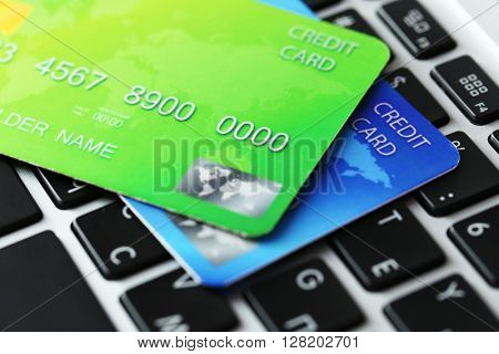 Credit cards on keyboard, close up