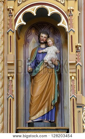 STITAR, CROATIA - AUGUST 27: St. Joseph holding baby Jesus, altar of St. Anthony the Great in the church of Saint Matthew in Stitar, Croatia on August 27, 2015