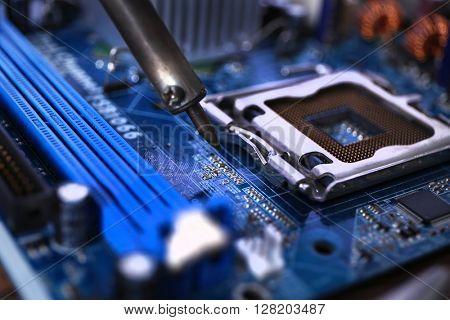 Soldering electronic circuits closeup