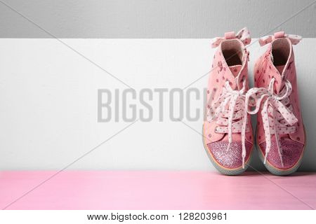 Gumshoes for girls on wall background