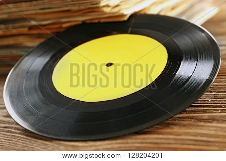 Old vinyl record with yellow label, close up