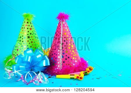 Funny party hats on blue background