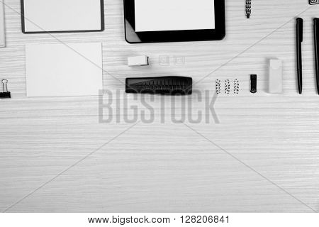 Office set with sheets of paper, tablet and stationery on light wooden background