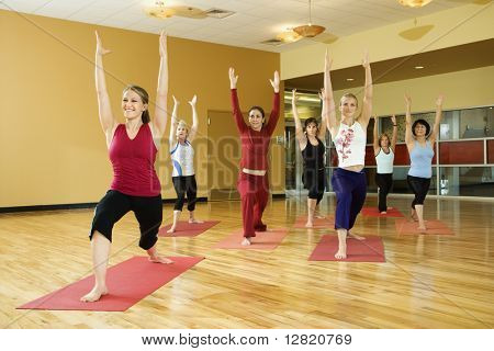 Prime adult female Caucasians in yoga class.