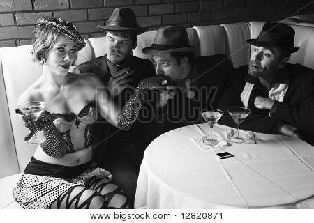 Three Caucasian prime adult males in retro suits wooing Caucasian prime adult female.