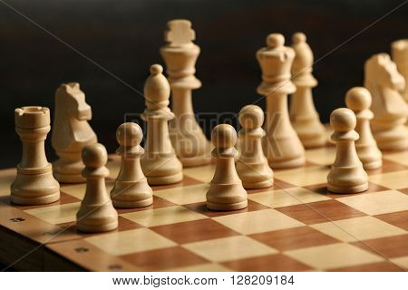 Chess pieces and game board closeup