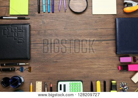 Frame of stationery on wooden background