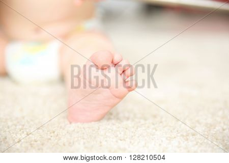Baby foot on a carpet, close up