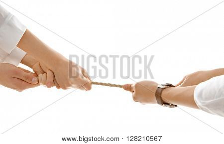People hands pulling rope for playing tug of war isolated on white